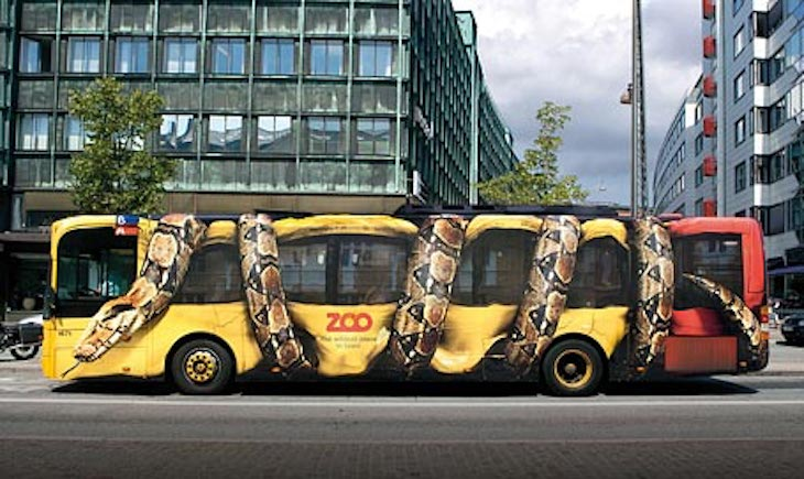 Let Copenhagen Zoo's snake bus spark your imagination to create your own bus wrap ad.