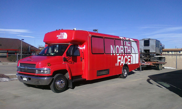 Customize your corporate bus rental with a bus wrap.