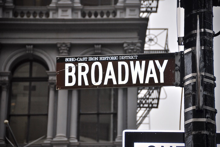 Rent a charter bus to explore Broadway in NYC.