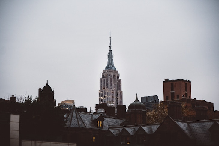 Rent a charter bus from a NYC airport to the Empire State Building.
