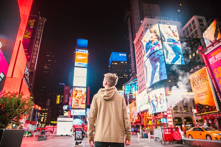 Rent a charter bus from NYC airports to Times Square.