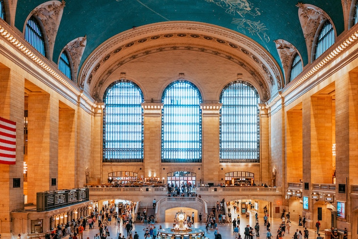 Rent a charter bus from a NYC airport to Grand Central Terminal.