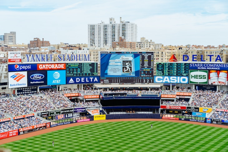 Rent a charter bus from a NYC airport to Yankee Stadium.