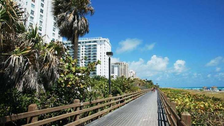 Rent a bus to Miami Beach Boardwalk.