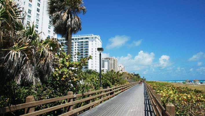 Miami charter bus rentals to Miami Beach Boardwalk.